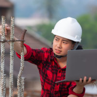 engineer holding laptop Check the construction work,Labor day concept